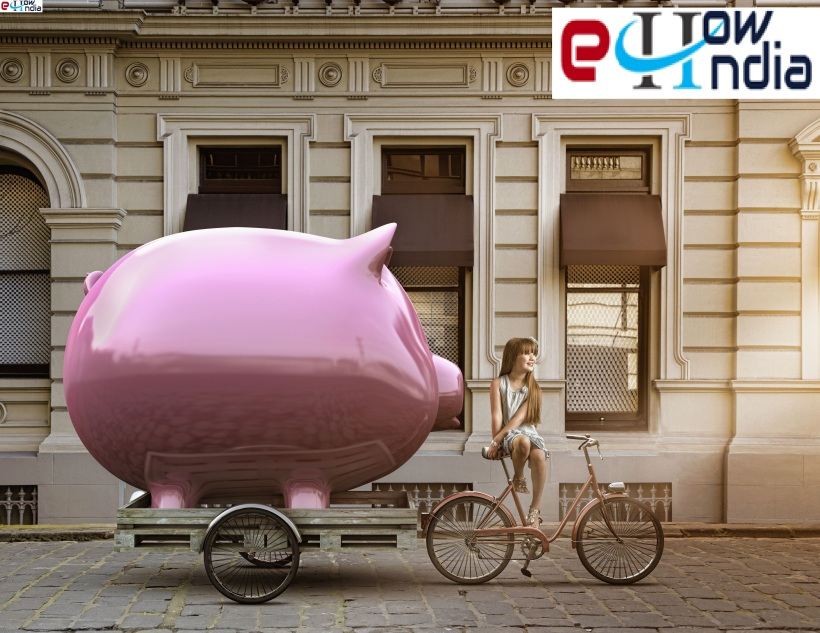 caucasian-girl-pulling-piggy-bank-on-bicycle-cart-464675085-578aad7e5f9b584d20fc4f6b.jpg